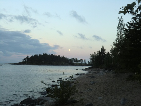 The moon over Ladoga lake in a gulf photo