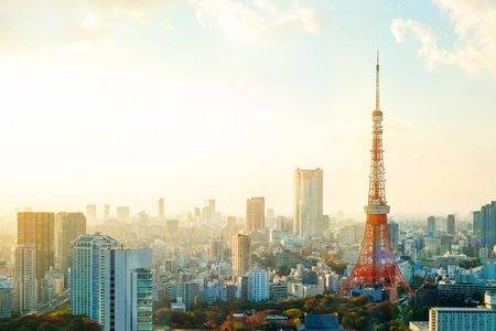 Business concept for real estate and corporate construction - Tokyo tower, landmark of Japan, and panoramic modern city bird eye view with dramatic sunrise and morning sky Stockfoto