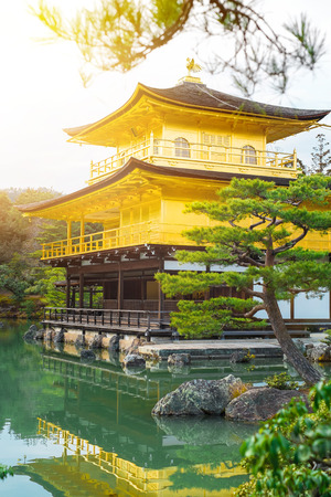 world cultural heritage: The world cultural heritage, Kinkaku Ji under dramatic morning sunshine, the traditional golden zen buddhist temple in Kyoto, Japan