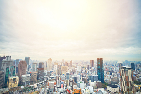 Business concept for real estate and corporate construction - panoramic modern city skyline bird eye aerial view with dramatic sunrise and morning sky in Osaka, Japan Stockfoto