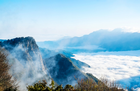 Beautiful morning sunrise, dramatic cloud of sea, giant rocks and Yushan mounatin under bright blue sky in Alishan(Ali mountain) National Park, Taiwan