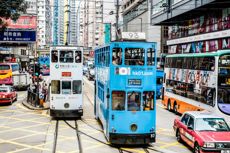 Urban day life in central district with tramways (Ding Ding car,famous tram/bus), the populated areas and international business and financial center in Hong Kong(HK), China