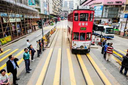 ding: Urban day life in central district with tramways (Ding Ding car,famous trambus), the populated areas and international business and financial center in Hong Kong(HK), China Editorial