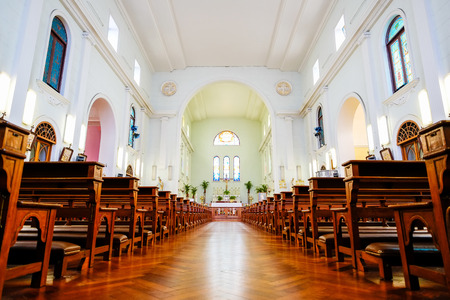 The interior view of traditional church with empty bench and aisle, the famous heritage in Macao/Macau, China Redactioneel
