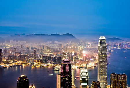 hk: Business concept for real estate and corporate construction - panoramic modern city skyline bird eye aerial view with night sky in Hong Kong (HK), China