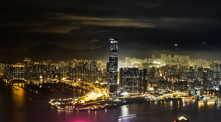 urban scene: Business concept for real estate and corporate construction - panoramic modern city skyline bird eye aerial view with night sky in Hong Kong (HK), China