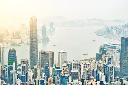 hk: Business concept for real estate and corporate construction - panoramic modern city skyline bird eye aerial view with dramatic sunrise and morning blue sky in Hong Kong (HK), China Stock Photo