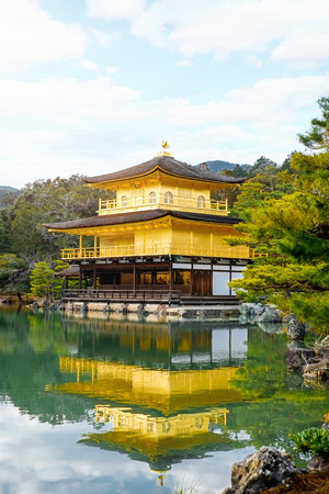 world cultural heritage: The world cultural heritage, Kinkaku Ji under morning sky, the traditional golden zen buddhist temple in Kyoto, Japan Editorial