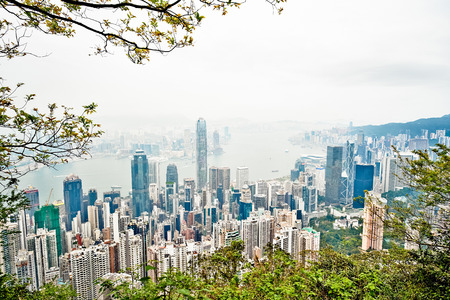 hk: Business concept for real estate and corporate construction - panoramic modern city skyline bird eye aerial view with morning grey sky in Hong Kong (HK), China