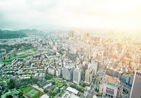 Business concept for real estate and corporate construction : panoramic modern city bird eye view with dramatic sunrise and morning blue sky from 101 building in Taipei, Taiwan