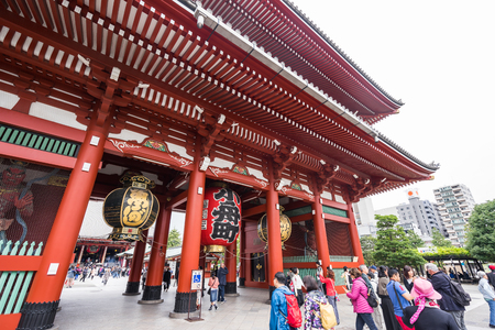 Toyko, Japan - 13 October 2016: Tourists walk on Senso ji shrine red gate. the history culture Heritage in Asakusa district, Tokyo, Japan