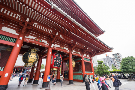 senso ji: Toyko, Japan - 13 October 2016: Tourists walk on Senso ji shrine red gate. the history culture Heritage in Asakusa district, Tokyo, Japan