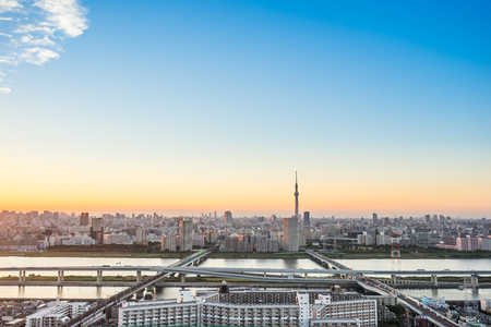 Business and culture concept - panoramic modern city skyline bird eye aerial view with tokyo skytree under dramatic sunset glow and beautiful cloudy sky in Tokyo, Japan Editorial
