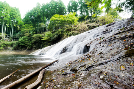Japan travel concept - beautiful yoro keikoku valley waterfall under sun glow and morning blue sky in Chiba Prefecture, Japan Stock Photo
