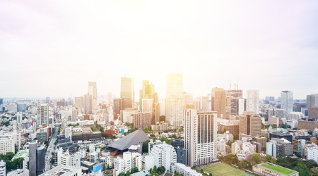 dramatic sunrise: Business and culture concept - panoramic modern city skyline bird eye aerial view from tokyo tower under dramatic sunrise and morning blue sky in Tokyo, Japan