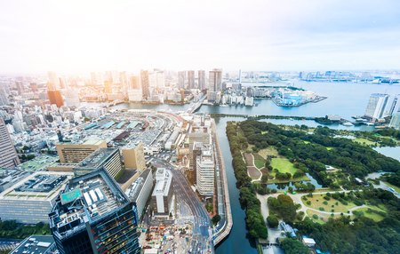 dramatic sunrise: Business and culture concept - panoramic modern city skyline bird eye aerial view of Odaiba bay and bridge under dramatic sunrise and morning blue cloudy sky in Tokyo, Japan