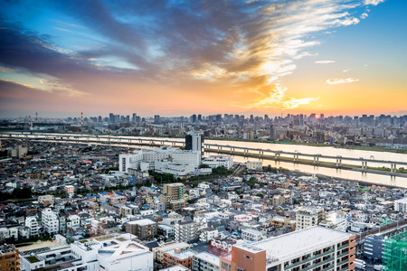 Business and culture concept - panoramic modern city skyline bird eye aerial view with Mountain Fuji under dramatic sunset glow and beautiful cloudy sky in Tokyo, Japan Editorial
