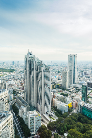 Business and culture concept - panoramic modern city skyline bird eye aerial view under dramatic sun and morning blue cloudy sky in Tokyo, Japan Editorial