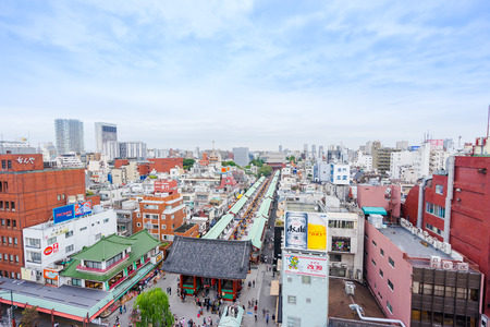 dramatic sunrise: Business and culture concept - panoramic modern city skyline bird eye aerial view with Sensoji-ji Temple shrine - Asakusa district under dramatic sunrise and morning blue sky in Tokyo, Japan