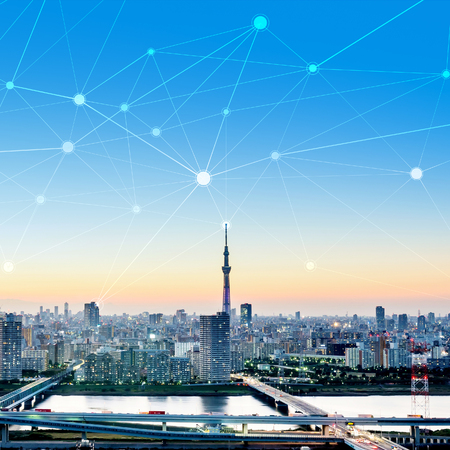 Business concept for information, communication , connection technology - panoramic modern city skyline bird eye aerial night view under dramatic glow and beautiful dark blue sky