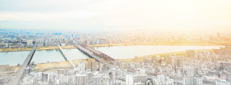 Asia Business concept for real estate and corporate construction - panoramic modern cityscape building bird eye aerial view under sunrise and morning blue bright sky in Osaka, Japan. Mix hand drawn sketch illustration