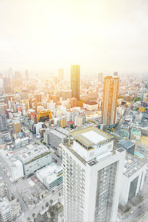 townscape: Asia Business concept for real estate and corporate construction - panoramic modern cityscape building bird eye aerial view under sunrise and morning blue bright sky in Osaka, Japan. Mix hand drawn sketch illustration