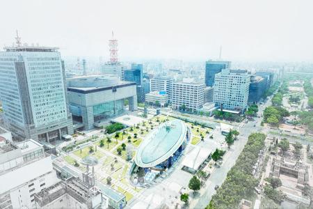 Panoramic modern city bird eye view on Nagoya TV Tower, landmark of Nagoya. Oasis21, Aichi art center and holly tree plaza under modern city in Japan. Mix hand drawn sketch illustration Stock Photo