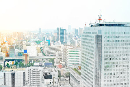 under view: Asia Business concept - panoramic modern cityscape building bird eye aerial view under sunrise and morning blue bright sky from Nagoya TV Tower in Nagoya, Japan mix hand drawn sketch illustration