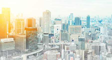 under view: Asia Business concept for real estate and corporate construction - panoramic modern cityscape building bird eye aerial view under sunrise and morning blue bright sky in Osaka, Japan. Mix hand drawn sketch illustration