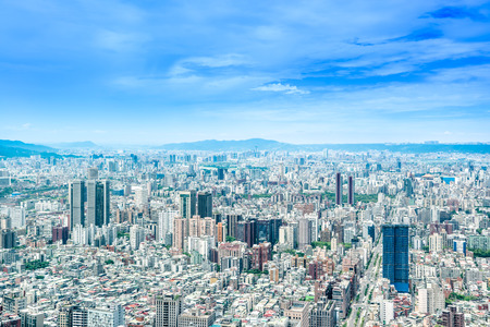 Asia Business concept for real estate and corporate construction - panoramic modern cityscape building bird eye aerial view under sunrise and morning blue bright sky, shot in Taipei 101, Taiwan
