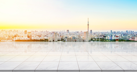 Business concept - Empty marble floor top with panoramic modern cityscape building bird eye aerial view under sunrise and morning blue bright sky of Tokyo skytree, Japan for display or montage product
