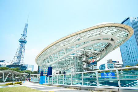 Business concept for real estate and corporate construction - Nagoya TV Tower and Oasis21, landmark of Nagoya, under modern city view with blue and sunny morning sky in Japan