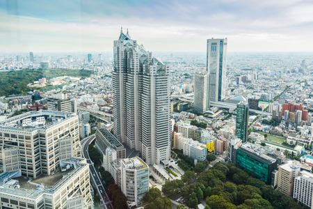 Business and culture concept - panoramic modern city skyline bird eye aerial view under dramatic sun and morning blue cloudy sky in Tokyo, Japan Stockfoto