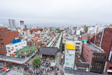 Business and culture concept - panoramic modern city skyline bird eye aerial view with Sensoji-ji Temple shrine - Asakusa district under dramatic sunrise and morning blue sky in Tokyo, Japan