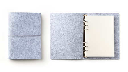 Business concept - Top view collection of grey spiral notebook on white background desk for mockup