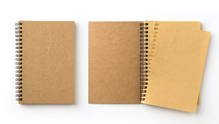 Business concept - Top view collection of spiral kraft notebook on white background desk for mockup Stock Photo