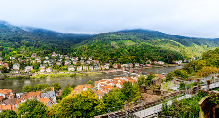 Europe culture concept - panoramic city skyline birds eye aerial view under dramatic sun and morning blue cloudy sky in Heidelberg, Germany Stock Photo