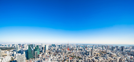 Asia Business concept for real estate and corporate construction - panoramic modern city skyline bird eye aerial view of tokyo tower and odaiba under blue sky in Roppongi Hill, Tokyo, Japan Stock Photo