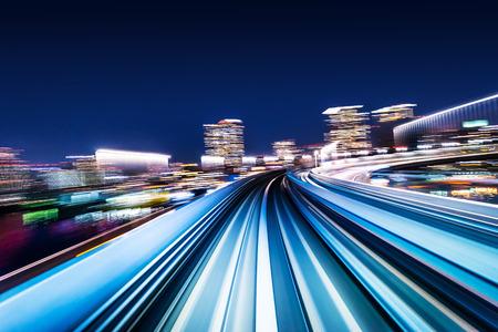 ビジネスコンセプト - 東京の背景のためのモーションライトの高速抽象MRTトラック、日本 写真素材