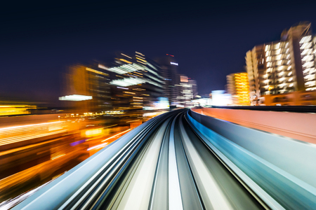 Business concept - high speed abstract MRT track of motion light for background in tokyo, japan Imagens