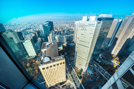 Asia Business concept for real estate and corporate construction - panoramic modern city skyline aerial view of Shinjuku area under blue sky in Tokyo, Japan Stock Photo - 96295472