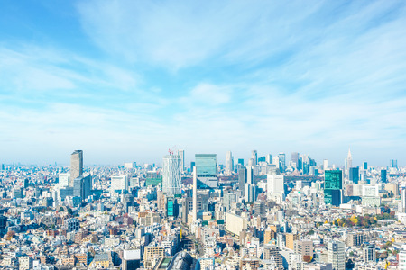 Asia Business concept for real estate and corporate construction - panoramic modern city skyline aerial view of Shinjuku area under blue sky in Tokyo, Japan 스톡 콘텐츠