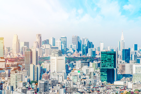 Asia Business concept for real estate and corporate construction - panoramic modern city skyline aerial view of Shinjuku area under blue sky in Tokyo, Japan Stock Photo