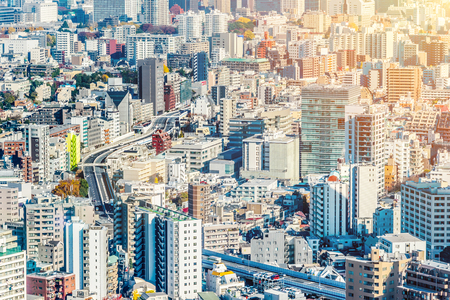 Asia Business concept for real estate and corporate construction - panoramic modern city skyline aerial view of Odaiba area and Tokyo Metropolitan Expressway under blue sky in Tokyo, Japan Editorial