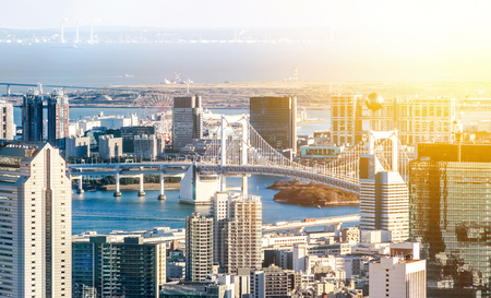 Asia Business concept for real estate and corporate construction - panoramic modern city skyline bird eye aerial view of Odaiba & rainbow bridge in Roppongi Hill, Tokyo, Japan Editorial
