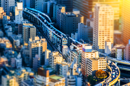 Asia Business concept for real estate and corporate construction - Tokyo Metropolitan Expressway junction in Roppongi Hill, Tokyo, Japan. Miniature Tilt-shift effect Stockfoto