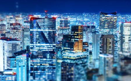 Panoramic modern city skyline view with neon night in Roppongi Hill, Tokyo, Japan. Miniature Tilt-shift effect Stock Photo