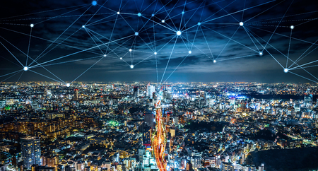 Business concept for information, communication , connection technology - panoramic modern city skyline, bird eye aerial night view under beautiful dark blue night sky in Roppongi Hill, Tokyo, Japan. Reklamní fotografie