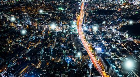 Panoramic modern city skyline, bird eye aerial night view under beautiful dark blue night sky in Roppongi Hill, Tokyo, Japan. Stock Photo
