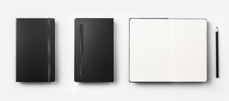 Business concept - Top view collection of black fly black notebook front, back and white open page, pencil isolated on background for mockup